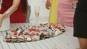 Tray with delicious sweets at a banquet stock video footage