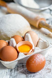 Tray with eggs, dough and rolling pin. Royalty Free Stock Photo