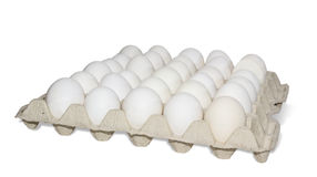 Tray with eggs. Tray with white chicken eggs on a light background. Isolation Royalty Free Stock Photography