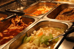 Tray filled with food inside the self service Chinese rest Stock Photography