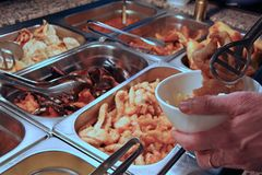 Tray filled with fried meat and fish within the self service res Royalty Free Stock Photography