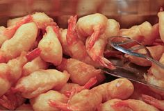 Tray filled with shrimp and fried crawfish tails in a rest Stock Images