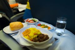 Tray of food on the airplane royalty free stock images