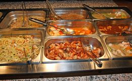 Tray with food inside the self service Chinese restaurant Stock Photos