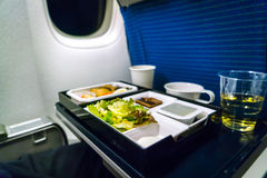 Tray of food on plane . Royalty Free Stock Photography