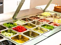 Tray with food on showcase at cafeteria stock photo