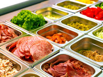 Tray with  food  on showcase at cafeteria Stock Photos