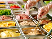 Tray with food on showcase at cafeteria. Tray with cooked food on showcase at cafeteria royalty free stock photo