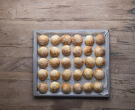 A tray of frech baked buns on a wooden table Stock Photo