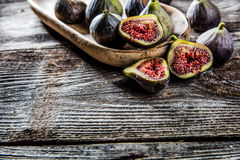 Tray of fresh ripe figs on authentic table background Royalty Free Stock Photo