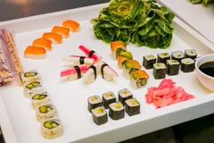 Tray of fresh sushi at gala event. White square Waiter Tray of fresh sushi for catering at a gala event or party Stock Photography