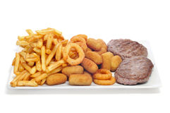 Tray with fried and fattening food. Closeup of a spanish combo platter with burgers, croquettes, calamares and french fries stock photography