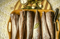 Tray with frozen fish and spices on the kitchen table Stock Photo
