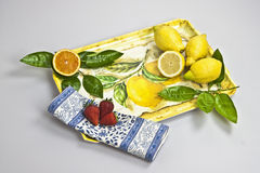 Tray with fruits. A tray with orange, lemons and strawberries Royalty Free Stock Photography