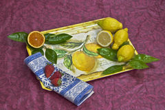 Tray with fruits. A tray with orange, lemons and strawberries Stock Photos
