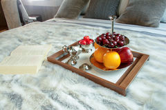 Tray with fruits on a bed in a hotel room Stock Photos