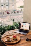 Tray of Fruits and Coffee Near Powered-on Laptop on Brown Table royalty free stock photos