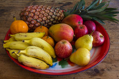 Tray of fruits. Colorful tray with fresh fruits on a wooden table Stock Photos