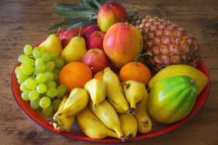 Tray of fruits. Colorful tray with fresh fruits on a wooden table Stock Images