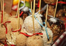 Tray full of caramel and candied apples. Stock Image