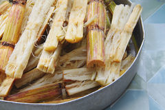 Tray full of crushed sugar cane. Crushed sugar cane in a aluminium tray waiting to be boiled. Concept for tropical drink preparation Royalty Free Stock Photo