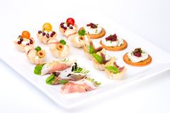 Tray full of fresh canapes Royalty Free Stock Photos