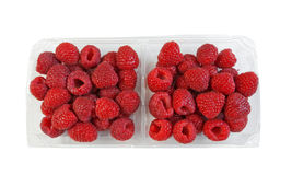 Tray full with fresh raspberries. Fresh sweet raspberries in a plastic tray Royalty Free Stock Photo