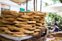 Tray full of Greek traditional round sesame bread rings, displayed in a street market with bokeh background Stock Image