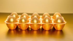 A tray of golden eggs, the concept of financial success.  Royalty Free Stock Photos