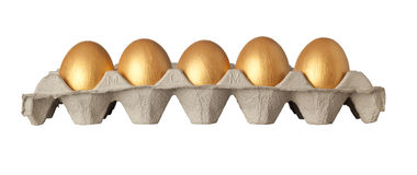 Tray of golden eggs Stock Image