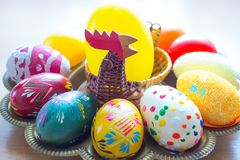 Hand painted eggs on a tray for easter with a hen Royalty Free Stock Image