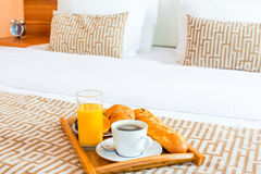Tray with healthy breakfast in bed royalty free stock photography