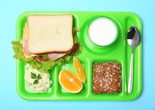 Tray with healthy food for school child on color background. Top view royalty free stock photos
