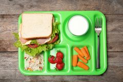 Tray with healthy food for school child on wooden background. Top view royalty free stock images