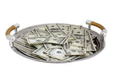 Tray with heap of dollars Stock Images