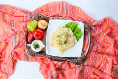 Tray with hingal with cheese and vegetabl, traditional Azerbaijani cuisine. Top view. Royalty Free Stock Photography
