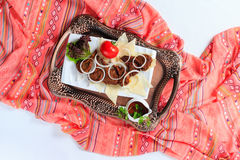 Tray with hingal with grilled lamb chops. Stock Photos
