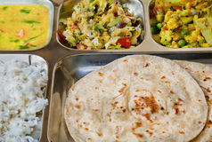 Tray with Indian dish thali, subji, rice and chapati bread Royalty Free Stock Photography