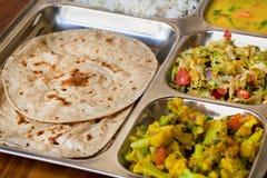 Tray with Indian dish thali, subji, rice and chapati Stock Photos