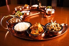 Tray of Indian dishes on table Stock Photos