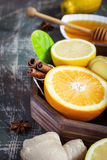 Tray with ingredients for making immunity boosting  healthy vitamin drink On dark background Stock Photo