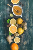 Tray with ingredients for making immunity boosting  healthy vitamin drink On dark  turquoise background Stock Photography