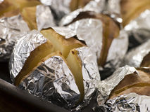Tray of Jacket Potatoes Wrapped in Foil Stock Photos