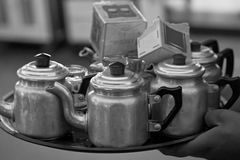 Tray with kettles and tea. Carried by Moroccan boy Royalty Free Stock Photo