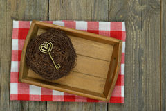 Tray and key on wooden background Stock Photos
