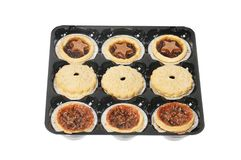 Tray of mince pies. Festive mini mince pies in a plastic tray isolated against white royalty free stock photos