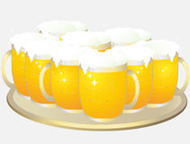 Tray with mugs of light beer Royalty Free Stock Photography