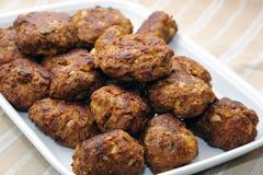 Tray of onion bhajjis. Pile of onion bhajjis on tray Stock Photo