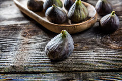 Tray of organic figs on authentic table background Royalty Free Stock Photo