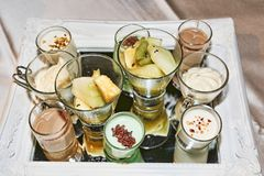 Tray with panna cotta desserts, coffee cream and fruit salad stock photo